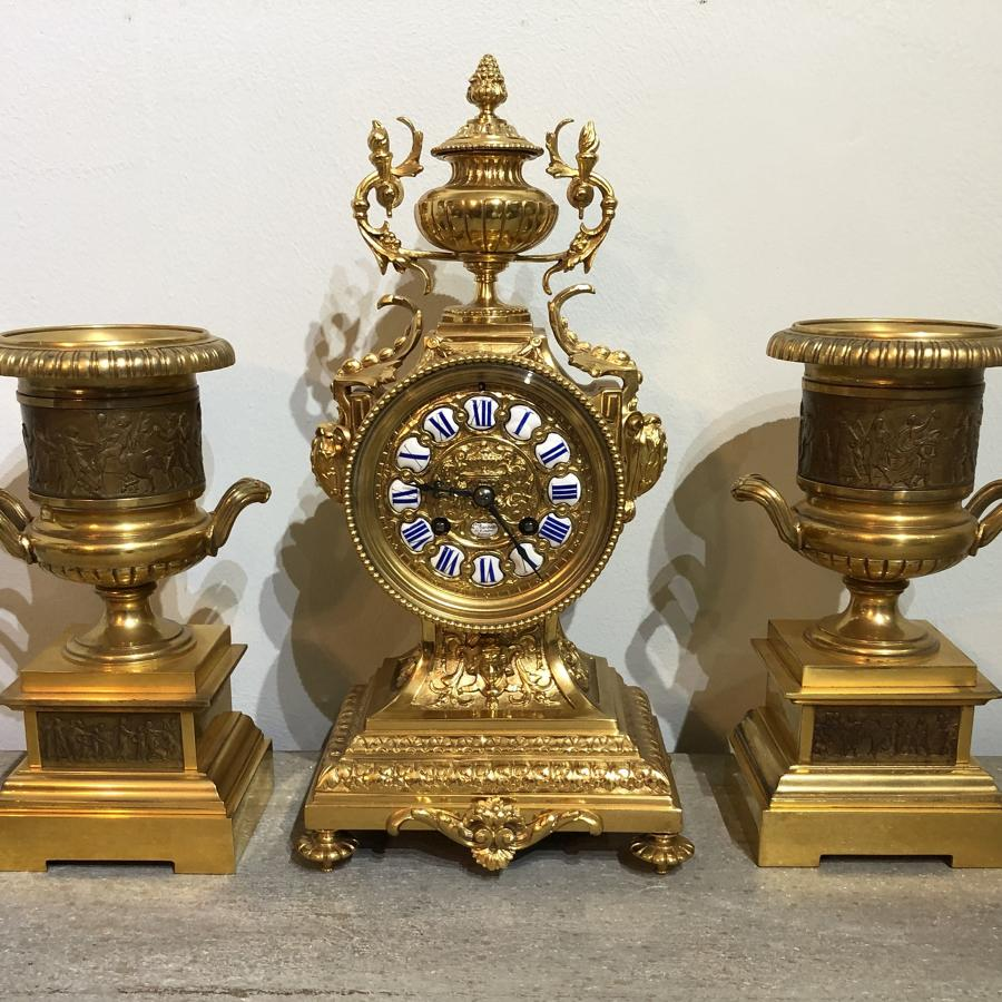 A French Ormalu Clock Garniture