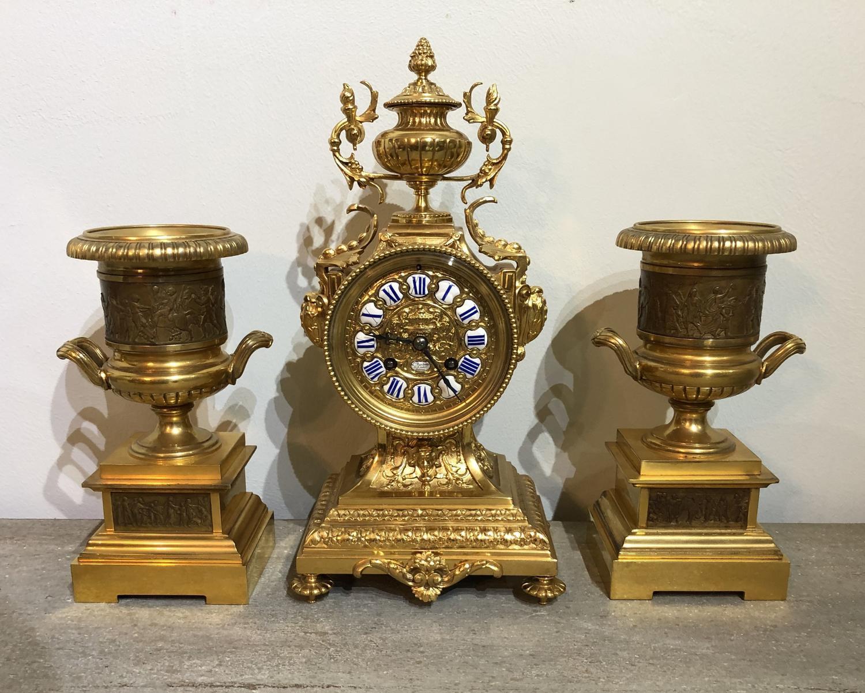 A French Ormalu Clock Garniture
