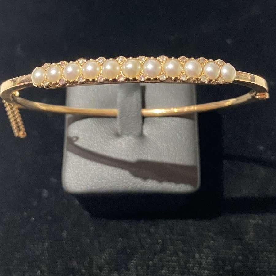 An Edwardian Pearl & Diamond Bangle