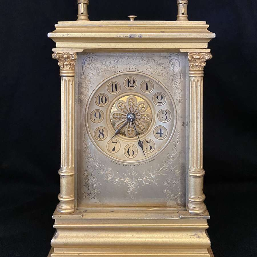 A Cased Striking Carriage Clock